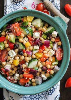 The Easiest Chopped Chickpea Greek Salad by ambitiouskitchen: Vegetarian Chickpea salad with olives, feta, tomatoes, onion, garlic and a light lemon dressing. Add quin…