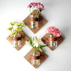 Mason jar sconces with fresh flowers