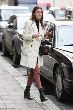 Bizarre ensemble: Lucy's outfit comprised of a host of different styles and colours as she...