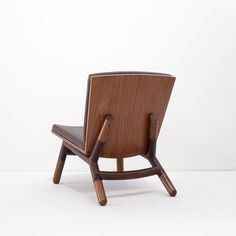 The 'Java' low chair designed by Carlos Motta is made from reclaimed Peroba Rosa wood oxidized iron and leather upholstery. Combining a rustic and clean design the 'Java' is a great example of Mottas work and his sophisticated yet laid-back aesthetics.
