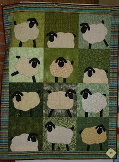 """Sheep in Shetland"" by Nicky Hunter Smith. Machine pieced with 3D heads and tails. Machine quilted by Tonia Woodburn. From the Tollgate Quilters Guild in Durban Kwa Zulu Natal South Africa ~ October, 2011."