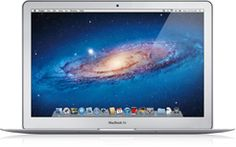MacBook Air, 18,8 Ghz, 256 GB SSD, 4GB RAM and a glowing Apple Logo