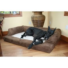 Your big dog will love lounging on this plush XL dog couch from Hidden Valley. Done in neutral combinations of durable microsuedes and taupe polar fleece. It will blend in perfectly with any design theme, and the removable cover makes cleaning a cinch.