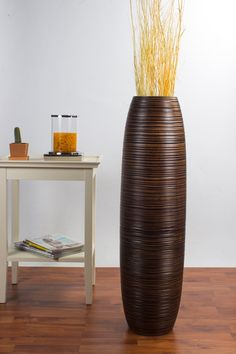 Tall Floor Vase 36 inches, Wood, Brown. Unique and distinguished floor vase for living rooms, shops, offices, hotels and restaurants. Hand-made interior deco as a tasteful addition to all furnished rooms. Exquisite floor vase in timeless design: perfect for corners. Combine two sizes for an even more impressive effect. High quality craftsmanship from extraordinary material. Decorating with long blades of grass, twigs or dry bouquets highlights the vase.