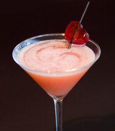 All-American Sweetheart Martini (•2-1/2 oz vodka •1-1/2 oz peach schnapps •1 oz orange juice •1 oz strawberry puree)