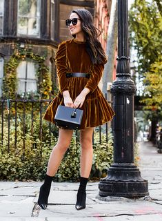 Sydne Style shows how to wear the sock booties trend with fashion blogger Wendys Lookbook in a velvet dress #boots #booties #shoes