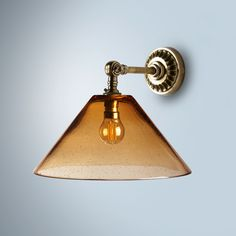 dahlia wall light in amber blown glass with rose wall light fitting in antiqued brass