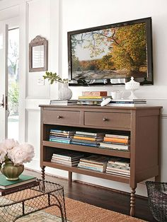 "Multiple Choices: Trick #4: Think versatility. In this living room, a dresser becomes a media console and, with drawers removed, a bookcase. ""It's also like a mantel, giving me a place to create a focal point,"" Doug says."