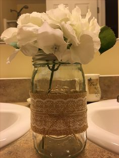 Silk hydrangeas in a mason jar with  burlap, lace and twine.  Use glue dots for quick and easy crafting.  Holly Early, 2016.