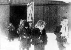 Children leave the Birkenau concentration camp after being liberated