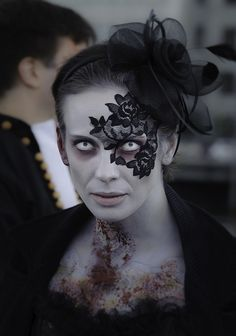 Costume inspiration: Fashionable zombie! From the Stockholm Zombie Walk 2013 Lace masquerade mask by LacedAndWaisted (reusable; adheres to skin) LacedAndWaisted.com