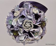 Brooch kissing ball for the bridesmaids! #wedding #bouquet