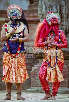 Male and female dancers at cultural event in Bhaktapur, Nepal - Photo by Tim Graham