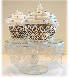 Filigree Cupcake Wrappers $.80 each - White 50 pack $40; also love the simple cupcake decoration.