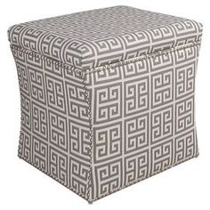 """Nailhead-trimmed storage ottoman with a pine wood frame and foam padding. Handcrafted in the USA.   Product: Storage ottomanConstruction Material: Solid pine, fabric and polyester fill foamColor: Onyx and dark greyFeatures:  Handmade in the USARemovable lidDimensions: 17"""" H x 19"""" W x 19"""" D  Cleaning and Care: Spot clean only"""