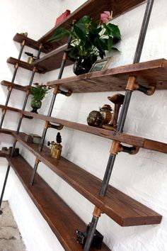 Niko Floor and Wall Mounted Mitred Corner Shelving made with Reclaimed Scaffolding Boards, Dark Steel Pipe and Bronze Threaded Fittings - Its salvaged vintage industrial design works perfectly in a sophisticated, casu. Diy Garage Shelves, Pipe Shelves, Black Shelves, Wall Mounted Shelves, Garage Storage, Wood Shelves, Corner Shelving Unit, Corner Bookshelves, Library Shelves