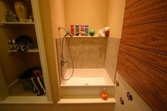 Dog Shower, with a curtain or shower door to contain the shakes.