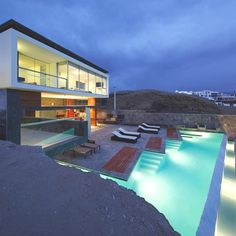 This pool is stunning, as is the house.