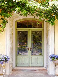This mostly-glass front door makes a beautiful statement! Find more front doors here: http://www.bhg.com/home-improvement/door/exterior/european-doors/?socsrc=bhgpin091614doubleduty&page=1