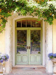 This mostly-glass front door makes a beautiful statement! Find more front doors here: http://www.bhg.com/home-improvement/door/exterior/european-doors/?socsrc=bhgpin091614doubleduty&page=1