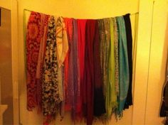 Scarves hung on mounted ribbon