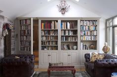 Secret Room Behind Faux Bookcase Door The end of this lounge area is covered in bookcases. The left section is a thin faux bookcase door that opens out, Hidden Door Bookcase, Bookcase Wall, Bookshelves, Fake Walls, Living Room Bookcase, Hidden Rooms, Classic Living Room, Secret Rooms, Living Furniture