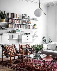 Cosy, loved and layered - we love this beautiful tactile room shot by @henriknero for @jfranzon. #layering #rug #turkishrug #kilim #loungeroom #styling #interiors #interiordesign #decor #homedecor #architecture #white #books #homelibrary #cosy #thestylephiles