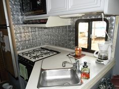 And the entire kitchen here. I LOVE it! So bright, updated, blingy…just my style. We had this same backsplash in one of our previous houses and I loved it there too. Total cost of this project was about $80 for the backsplash and about $15 in adhesive materials.
