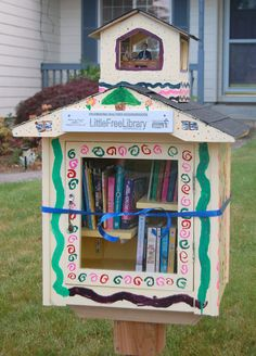 "Sonja Somerville. Salem, OR. My friends put up Salem's first Little Free Library and I rushed over to see it. I told my husband ""I know what I want for my birthday!"" He went to work and built this amazing structure. Because I am a librarian at a regular-sized public library we built a tiny library in a cupola at the top. It is furnished with my old dollhouse furniture and presided over by the official Librarian Action Figure: Seattle librarian Nancy Pearl. Best. Birthday. Present. Ever."