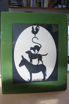 The musicians of Bremen, paper cut and framed, very pleased with how this turned out.