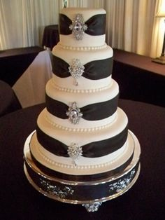 This cake is called Platinum and Pearls.  The ribbon is all sugar.  Working on making the brooches sugar.  This is a very popular cake design and it is one of my favorites as well.