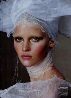 Beauty's latest muse - Lara Stone. Head wrapping by Justin D'ys, m/u Pat McGrath, Fashion Editor Grace Coddington.