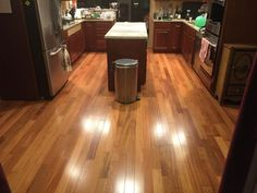 "Gorgeous Kitchen Redo with Brazilian Cherry: ""Our old floor was showing its age. We decided to put in hardwood and selected a strong wood to ensure durability. I'm sure you'll agree it is a great improvement."" – Jacob, VA 