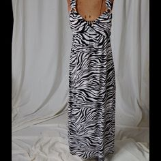 Zebra print maxi dress Zebra print Maxi dress.  Dress has wooden circle design above the bust area and criss crosses in back.  New with tags! HeartSoul Dresses Maxi