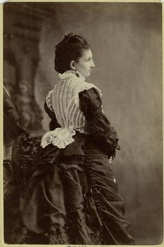 1870s. Unusual contrasting lace vest.