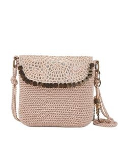 The new updated Kearny crossbody is slightly larger to carry everything you need. Inspired by The Sak crochet heritage, it's casual and crafted with a removable beaded dangle. Perfect to bring with you to the festivals, we love the hand crafted details and the wooden beads.