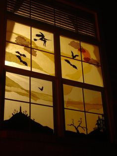 Outdoor Halloween Decorations - window silhouettes using tissue paper as background. Neat idea.