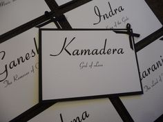 Black & White Wedding Table Names with bow detail .. named after Hindu Gods