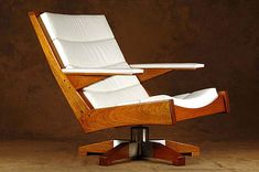 Carlos Motta Chair: This is definitely an Eames inspired lounge worth having.  Plus, it is made with reclaimed wood.