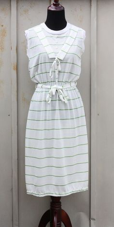 Adorable white and green striped skirt and short sleeve cardigan set from the 80s. The brand is MSH. Feels like cotton or rayon. Tagged size Medium. Please see measurements. Pulls over head to get on, has and elastic waist and matching belt. Also comes with a matching short sleeve cardigan. Very good vintage condition. May show minor wear but no notable issues.  Measurements:  **Taken buttoned, laying flat ***Chest - armpit to armpit ****Waist- smallest part of waist *****Length -shoulder to…
