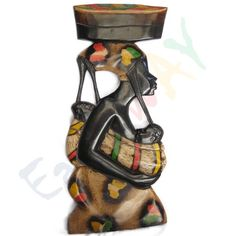 A wooden sculpture depicting how women struggle for their children. A perfect Gift for Mothers.