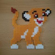 Simba (The Lion King) hama beads by Jenny Specht Hama Disney, Hama Beads Disney, Melty Bead Patterns, Pearler Bead Patterns, Perler Patterns, Beading Patterns, Perler Bead Templates, Diy Perler Beads, Perler Bead Art