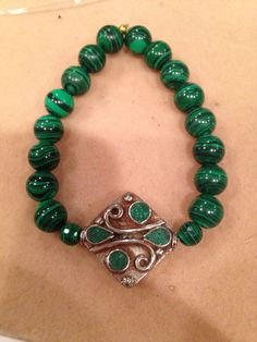 Malachite and silver malachite focal bead on Etsy, $40.00