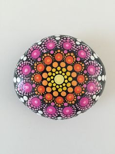 A personal favorite from my Etsy shop https://www.etsy.com/listing/293076861/mandala-stone-hand-painted-rock-dot