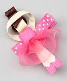 Uniquely designed and charmingly imaginative, this clip makes the perfect piece for jazzing up favorite outfits. Set atop a non-pinching alligator clip, it adds a major pop of personality to any little lovely's locks. 2'' W x 3'' HGrosgrain ribbon / metalImported