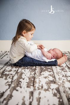 Newborn Sibling Photography. www.jacobstudios.com White shirt and jeans, swaddle blanket.