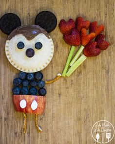 Mickey Moust Uncrustables Food Art - Find out how you can make this adorable Mickey Mouse Food Art using Smucker's Uncrustables Sandwiches! And how you can enter to win a trip to Disney Parks too! #ad