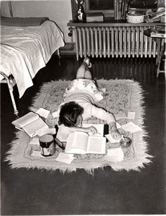 A teenager does her homework on the floor, 1950s. I did my homework on the floor in the 70's!