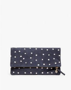 Simple, elegant foldover navy clutch from Clare Vivier with a pink spotted pattern. Features a minimalist rectangular silhouette, buttery soft nubuck, gold-tone zipper and lined interior with logo patch.  •	Navy foldover nubuck clutch •	Rectangular sil