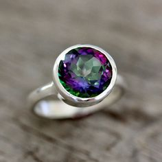 If I owned this ring, I don't know if I'd be able to NOT constantly stare at my hand. This is a Limited Edition Sterling Silver Ring with a Mystic Topaz by  onegarnetgirl on etsy